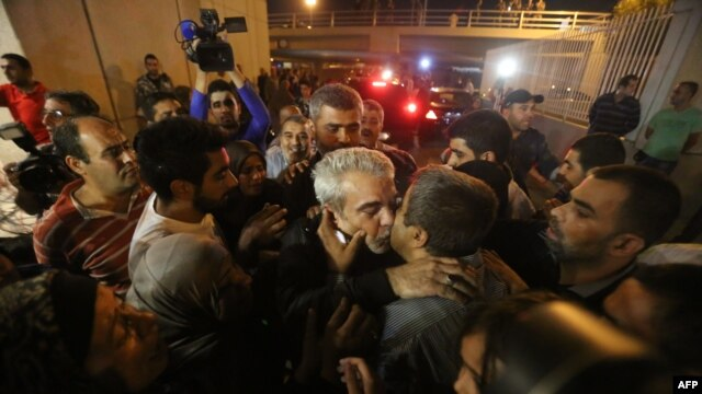 Nine Lebanese hostages are greeted by cheering crowds in Beirut.