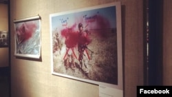 Photos at the exhibition in Moscow were doused with red paint.