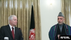 U.S. Defense Secretary Robert Gates speaks alongside Hamid Karzai on December 8.