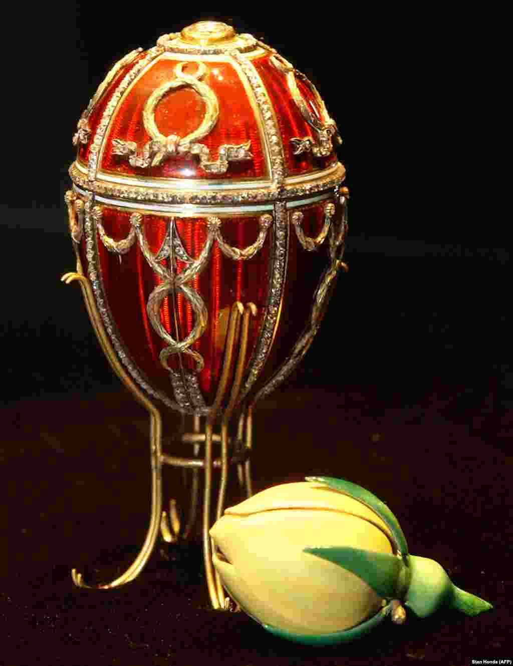 The Rosebud Egg, the first that Nicholas II gifted to his wife, Aleksandra. A cupid's arrow made from diamonds enlivens the red lacquer, while inside, an enamel rosebud symbolizes the love blooming between the newlyweds. A year after this egg was presented, a stampede at a celebration following Nicholas's coronation killed hundreds in the crowd. Following the advice of relatives, Nicholas proceeded with the coronation celebrations as ordinary Russians mourned their dead. It was his first fateful mistake as tsar.