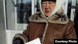 Тамара Ергазева, супруга арестованного нефтяника Жанбыра Ергазева. Жанаозен, 14 февраля 2012 года. Фото предоставила Дина Байдилдаева.