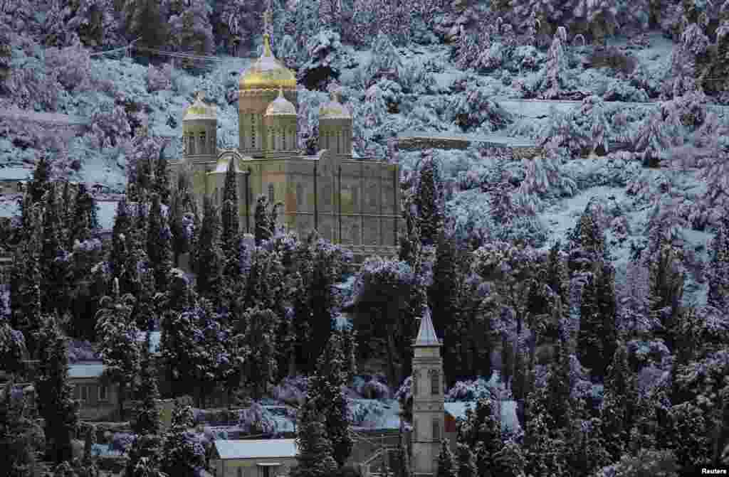 Snow covers the Russian Church in the neighborhood of Ein Kerem on the western outskirts of Jerusalem. The worst snowstorm in 20 years shut public transport, roads, and schools in Jerusalem and along the northern Israeli region bordering Lebanon. (Reuters/Ronen Zvulun)