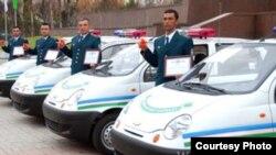 Uzbekistan -- Uzbek police cars, undated