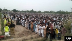 Pakistani relatives and residents offer funeral prayers for victims killed in the tanker on June 27.