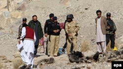 Pakistani security officials inspect the site of a bomb blast that targeted a vehicle of the Frontier Corps on January 2.