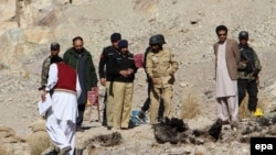 Pakistani security officials inspect the site of a bomb blast that targeted the vehicle of Frontier Corps, in Quetta, Balochistan Province on January 2.