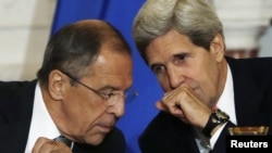 U.S. Secretary of State John Kerry (right) and Russian Foreign Minister Sergei Lavrov confer during a press briefing at the State Department in Washington on August 9.