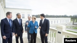 Президент США Барак Обама, президент Франции Франсуа Олланд, канцлер Германии Ангела Меркель, иллюстрационное фото