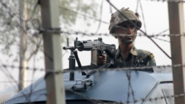 An Indian soldier patrols on the India-Pakistan border.