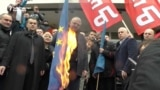 Serb War-Crimes Suspect Burns EU, NATO Flags In Belgrade