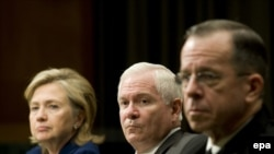 U.S. Secretary of State Hillary Clinton (left), Defense Secretary Robert Gates (center), and Chairman of the Joint Chiefs of Staff Michael Mullen participate in a Senate Armed Services Committee hearing in Washington, D.C.
