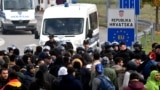 Bosnia-Herzegovina/Croatia - Asian migrants face mixed Bosnian and Croatian police road block during an illegal crossing attempt, at Maljevac border crossing with neighboring Croatia, near Northern-Bosnian town of Velika Kladusa, 24Oct2019