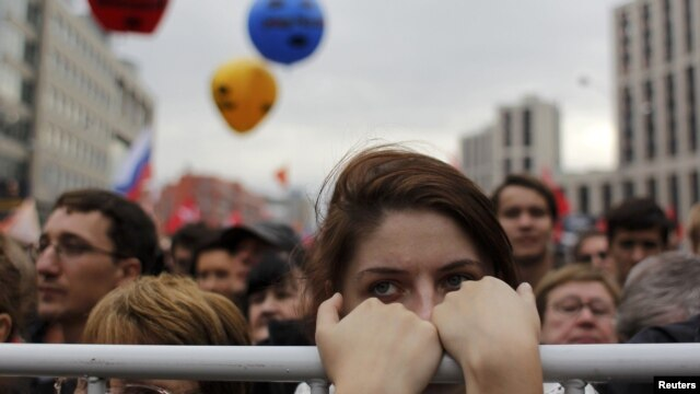 "Opposition supporters stand in front of the stage during the ""March of Millions"" protest rally in Moscow on September 15."