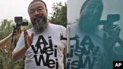 Activist artist Ai Weiwei speaks to journalists gathered outside his home in Beijing in June, after nearly three months of detention.
