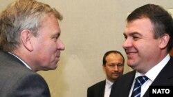 NATO's Jaap de Hoop Scheffer (left) meets with Russia's Anatoly Serdukov in Brussels