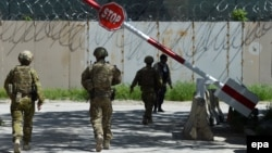 Australian Force members walk through the Green Zone in Kabul.