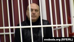 Belarusian fashion designer Sasha Varlamau appears in court during his trial on fraud and other charges in Minsk on February 4.