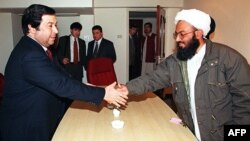 Turkmen Foreign Minister Boris Shikhmuradov (left) shakes hand with a senior Afghan Taliban official during a meeting in Islamabad in 1999.