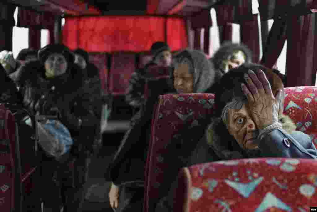 Local citizens sit in a bus as they wait to be evacuated from the besieged city of Debaltseve in Ukraine's eastern Donetsk region on February 3. (epa/Anastasia Vlasova)