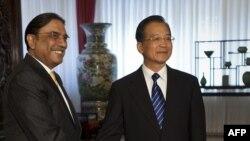 Pakistani President Asif Ali Zardari (left) and Chinese Prime Minister Wen Jiabao shake hands during their meeting at Zhongnanhai in Beijing in July.