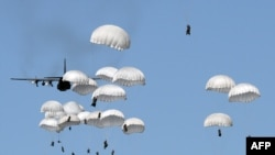 Polish troops land with parachutes at the military compound near Torun as part of the NATO Anaconda-16 military exercise in June.