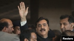Pakistani Prime Minister Yusuf Raza Gilani waves after arriving at the Supreme Court in Islamabad on April 26.