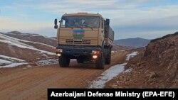 An Azerbaijani military vehicle moves along a road in the Kalbacar region on November 25.