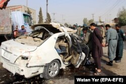Afghan security officials inspect the car in which Dayee was riding.