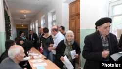 Voters case ballots in Nagorno-Karabakh's parliamentary elections on May 23.
