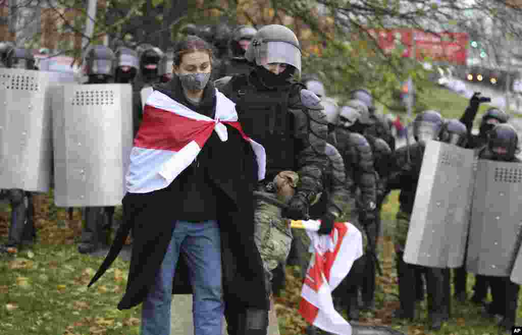 Belarusian police detain a protestor during an opposition rally in Minsk. (AP)