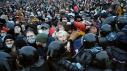 """""""Long live Belarus!"""" People clash with police during a protest against the jailing of opposition leader Aleksei Navalny in St. Petersburg, Russia, on January 23."""