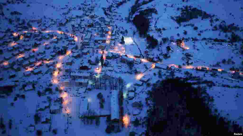 An aerial view of the east Bosnian town of Kalinovik covered by snow at night on February 9. (REUTERS/Dado Ruvic)