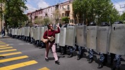 """An Armenian woman confronts a line of riot police on Yerevan's main avenue: """"I'm a journalist but before I'm a journalist I'm a citizen, and before you are police you are all citizens of Armenia!"""""""