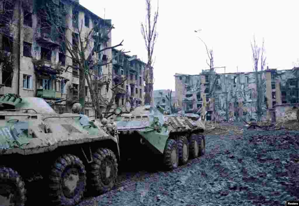 After weeks of bombardment, Chechen fighters retreat from Grozny and move into the mountains. This photo, taken on February 6, shows Russian armor patrolling the city.