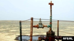 Нефтяная скважина после ликвидации утечки. Заглушенная скважина.