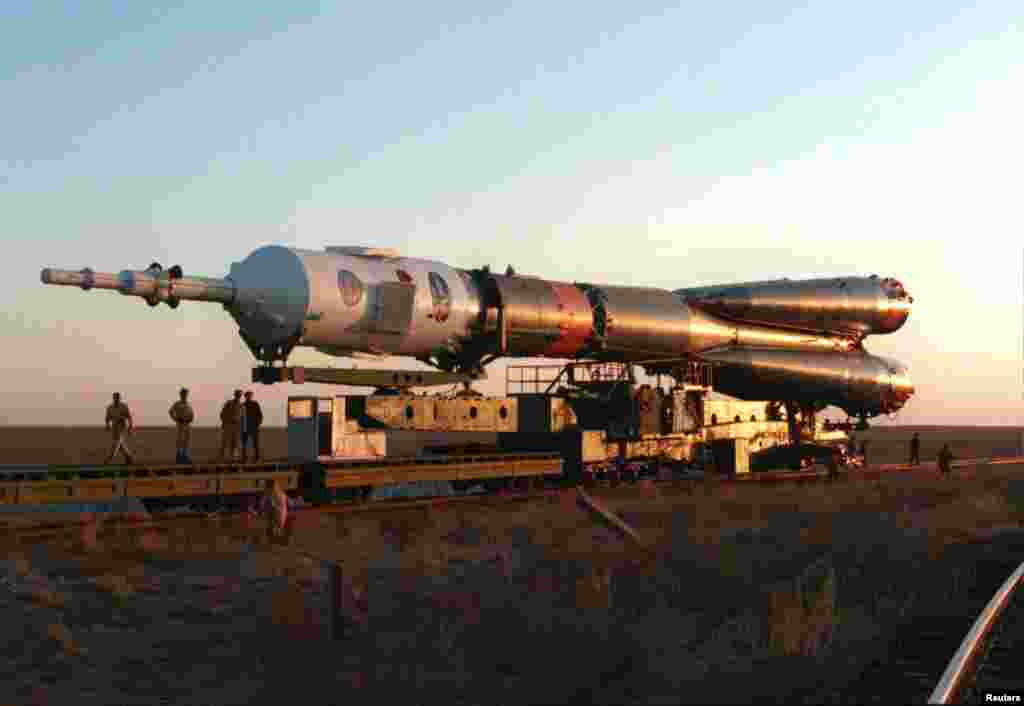 A Russian-made space rocket is transported by rail to the Baikonur launch site in October 1994.