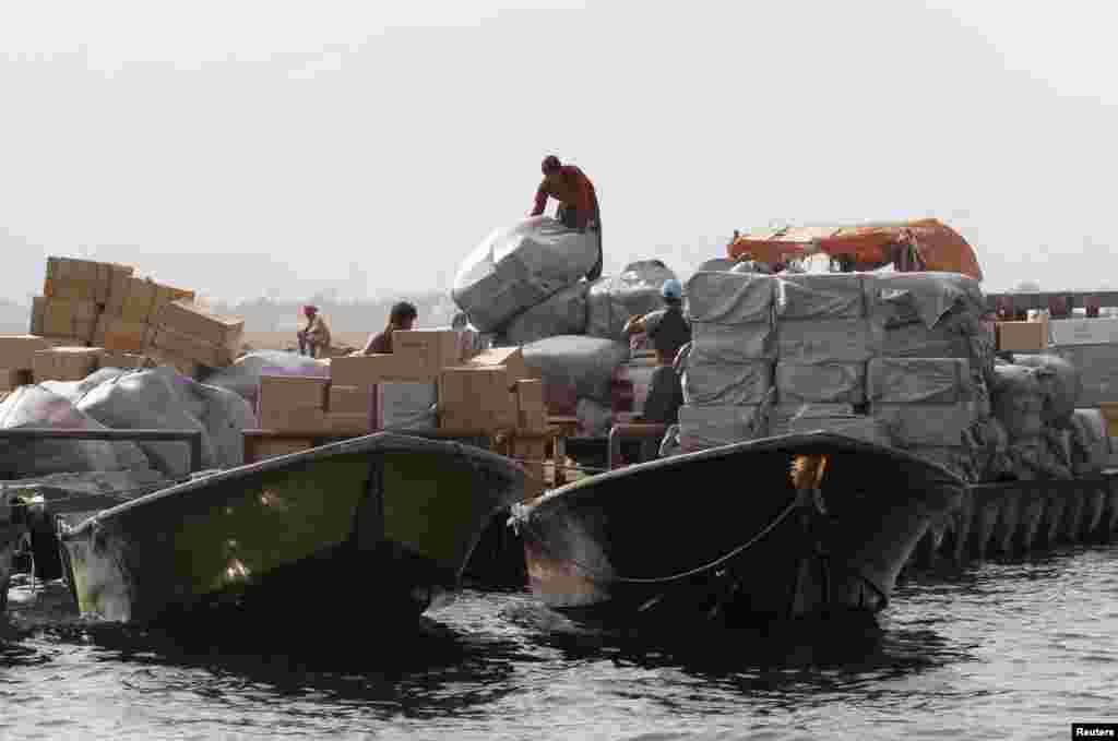 Iranian smugglers load goods at the Omani port of Khasab on September 26th 2012.