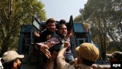 FILE: Police arrest protestors in Srinagar, the summer capital of Indian administered Kashmir in September.