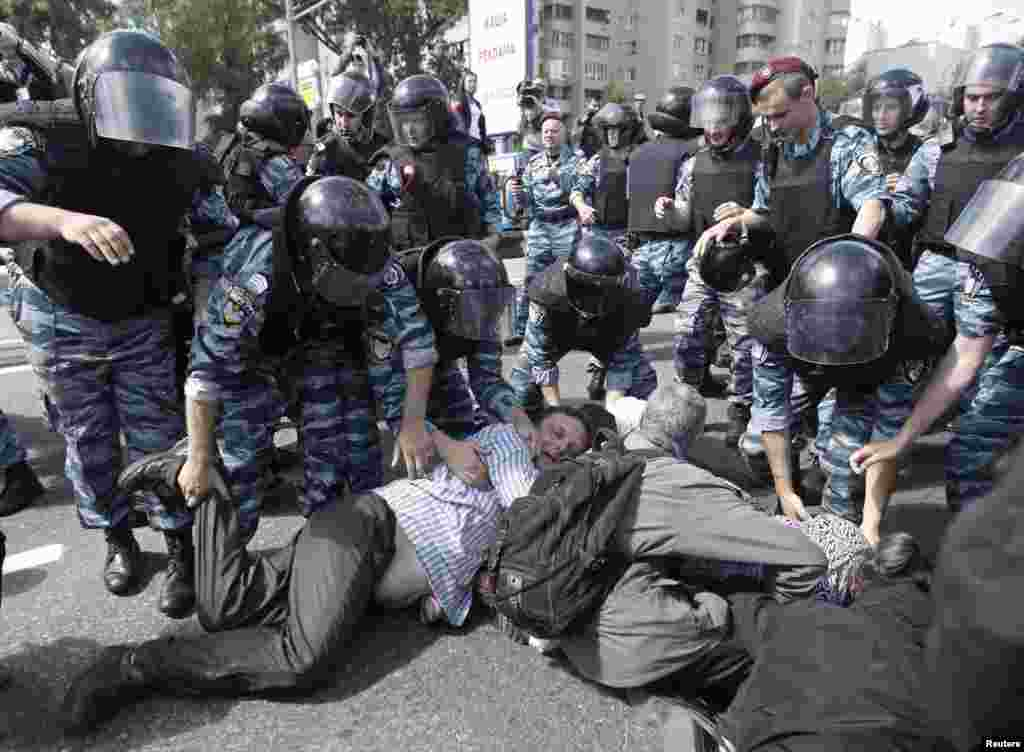 Riot police arrest Orthodox Christian activists trying to prevent the march.