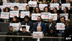 Germany -- Armenian clergy men and activists react after law makers voted to recognize the Armenian genocide after a debate during the 173rd sitting of the Bundestag, the German lower house of parliament, in Berlin, June 2, 2016