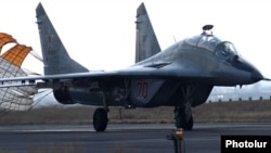 Armenia - A Russian MiG-29 fighter jet lands at Erebuni airport in Yerevan, 14Mar2014.