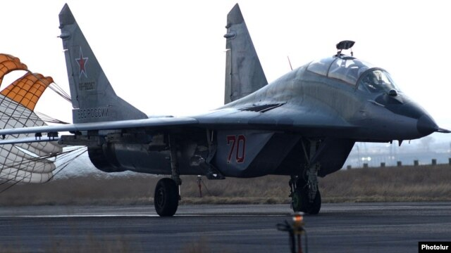 Armenia - A Russian MiG-29 fighter jet lands at Erebuni airport in Yerevan, 14Mar2014.