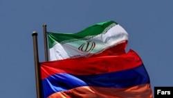Iran/Armenia – Geopolitics – The flags of Armenia and Iran, Tehran, July 2006