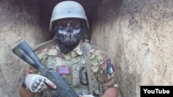 "A screen grab from a video that purportedly shows Vladimir Verbitsky (aka ""Parma"") involved with separatists in eastern Ukraine. He has since been arrested by the Italian police."