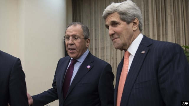 Russian Foreign Minister Sergei Lavrov (left) and U.S. Secretary of State John Kerry talk to reporters before their meeting in Beijing on November 8.