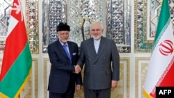 FILE PHOTO - Iranian Foreign Minister Mohammad Javad Zarif (R) meets with Oman's Minister of State for Foreign Affairs Yusuf bin Alawi bin Abdullah in Tehran, December 2, 2019