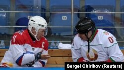 RUSSIA -- Russian President Vladimir Putin speaks with Belarusian President Alyaksandr Lukashenka (Right) during a hockey game at Shayba Arena in the Black Sea resort of Sochi, Russia February 15, 2019