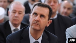 Syria -- President Bashar al-Assad attends Eid al-Fitr payers in Damascus, 19Aug2012