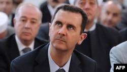 Syria -- President Bashar al-Assad attends Eid al-Fitr payers in Damascus, 19Aug2012