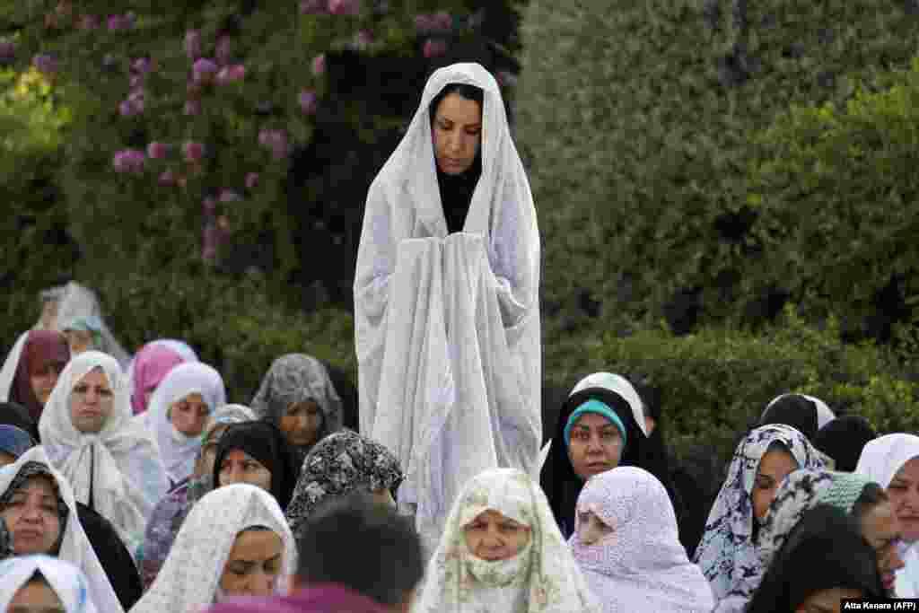 Iranian Muslim women perform Eid al-Fitr prayers in western Tehran.